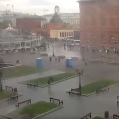 Watch: Crowds at Moscow's Red Square scramble for cover while being chased by...portable toilets