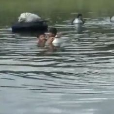 Watch: The bridge is missing. Jharkhand villagers use rubber tubes to cross the river, every day