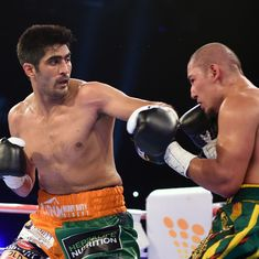Close call: Vijender Singh narrowly defeats Zulpikar to become double-title holder