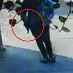 Caught on camera: Two armed men barge into a Dwarka apartment complex to escape the police