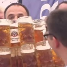 Watch: Man breaks record for carrying filled beer mugs (and doesn't drink a single one)