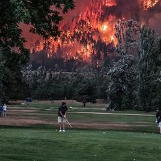 Believe it or not: Photograph of golfers playing a round during a wildfire goes viral