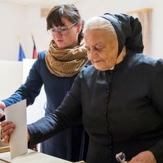 Voting under way for federal election in Germany, Angela Merkel expected to retain power