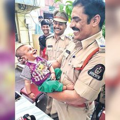 'Photo of the year': Twitter applauds the police inspector who saved a kidnapped baby boy