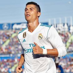 Ronaldo's late strike helps Madrid move up to second place, Suarez rescues point for Barca