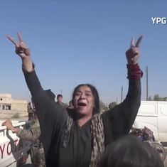 Watch the iconic moment a Syrian woman freed from ISIS tore off her coarse black robe