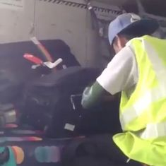 Caught on camera: Airport staff in Thailand rifling through passengers' luggage