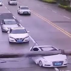 Caught on camera: Crane crashes on moving Audi in the middle of the road, driver survives