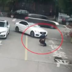 Caught on camera: Passers-by rush to lift car off a schoolboy after he was run over by it