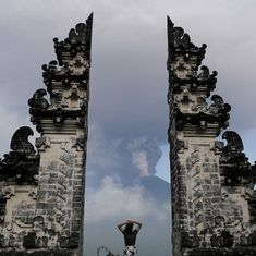 Tourists are stuck at the airport, but the erupting Mt Agung is worrying the Balinese in bigger ways