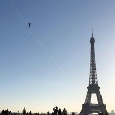 Watch this 22-year-old trapeze artist walk across the river Seine, 200 feet up in the air