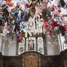 Video: A church in London opts for an unusual chandelier, one made out of refugee clothing