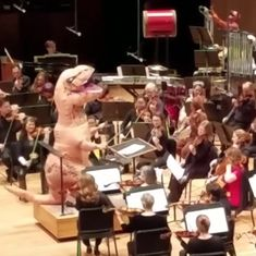 Nothing to see here. Just a T-Rex conducting an orchestra playing the theme of 'Jurassic Park'