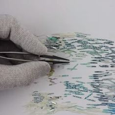 Watch: This incredibly patient man reconstructed a shredded banknote. But is it art?