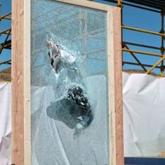 Watch this man leap through glass in slow motion (and try to understand why)
