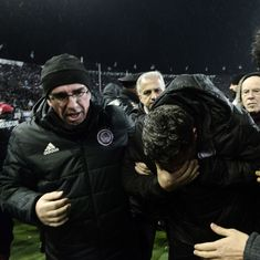 Olympiakos coach Oscar Garcia in hospital after being hit by a toilet roll during derby