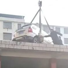 Watch: Parking in a 'no parking' zone in China may make a car end up on the roof of a building