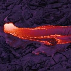 Watch: Glowing hot lava flowing out of a volcano in Hawaii is strangely beautiful