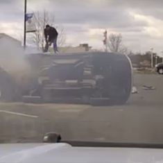 Caught on camera: Two men jumped to save a man trapped in an overturned, burning car