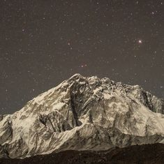 Everyone looks down from Mount Everest. This time-lapse video looks up at the magical sky instead