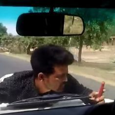 Watch: A UP government official drove his car for four kilometres with a man clinging to the bonnet
