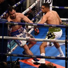Amir Khan knocks out Phil Lo Greco in 39 seconds in his first bout in two years