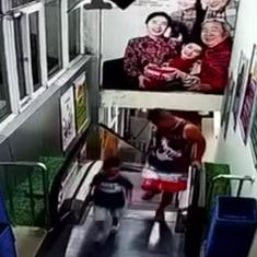 Watch: Horrifying video shows father and son step off an escalator moments before it crashes