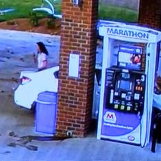 Watch: A car flew through the air and crashed at a gas station but the driver walked away unharmed