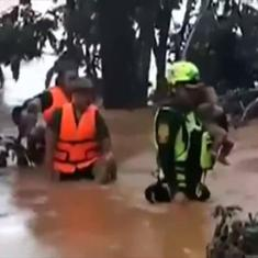Watch: Thai cave rescue team brings an infant (and 13 others) to safety after a dam collapse in Laos