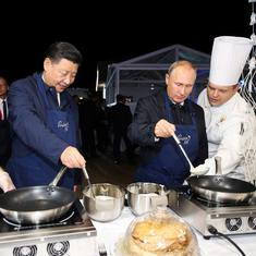 Watch: Taking a break from world domination, Vladimir Putin and Xi Jinping make and eat pancakes