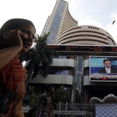 Sensex sinks over 500 points, rupee again ends below 72 against the dollar