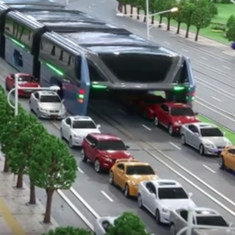 Watch: China has actually got that elevated bus onto the street, and it works (though very slowly)