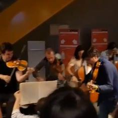 Watch: Flight delayed? Orchestra breaks  into impromptu concert to delight fellow passengers