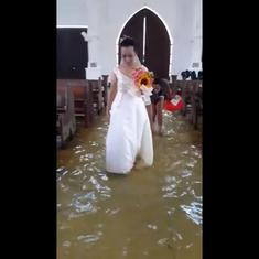 Watch: This bride wading down the aisle through a flood in the Philippines is winning hearts online