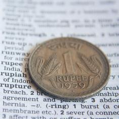 Rupee closes at record low of Rs 71.58, benchmark indices tumble