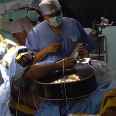 Watch: A patient on the operating table played the guitar as surgeons operated on his brain