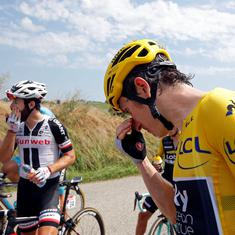 Tour de France briefly halted as police use tear gas to break farmers' protest