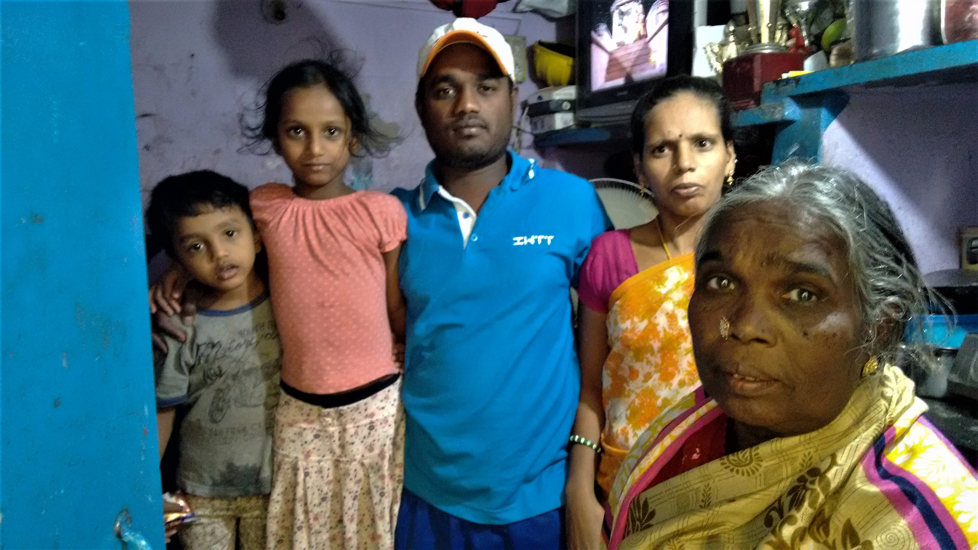 Shekar with his mother, wife and children.