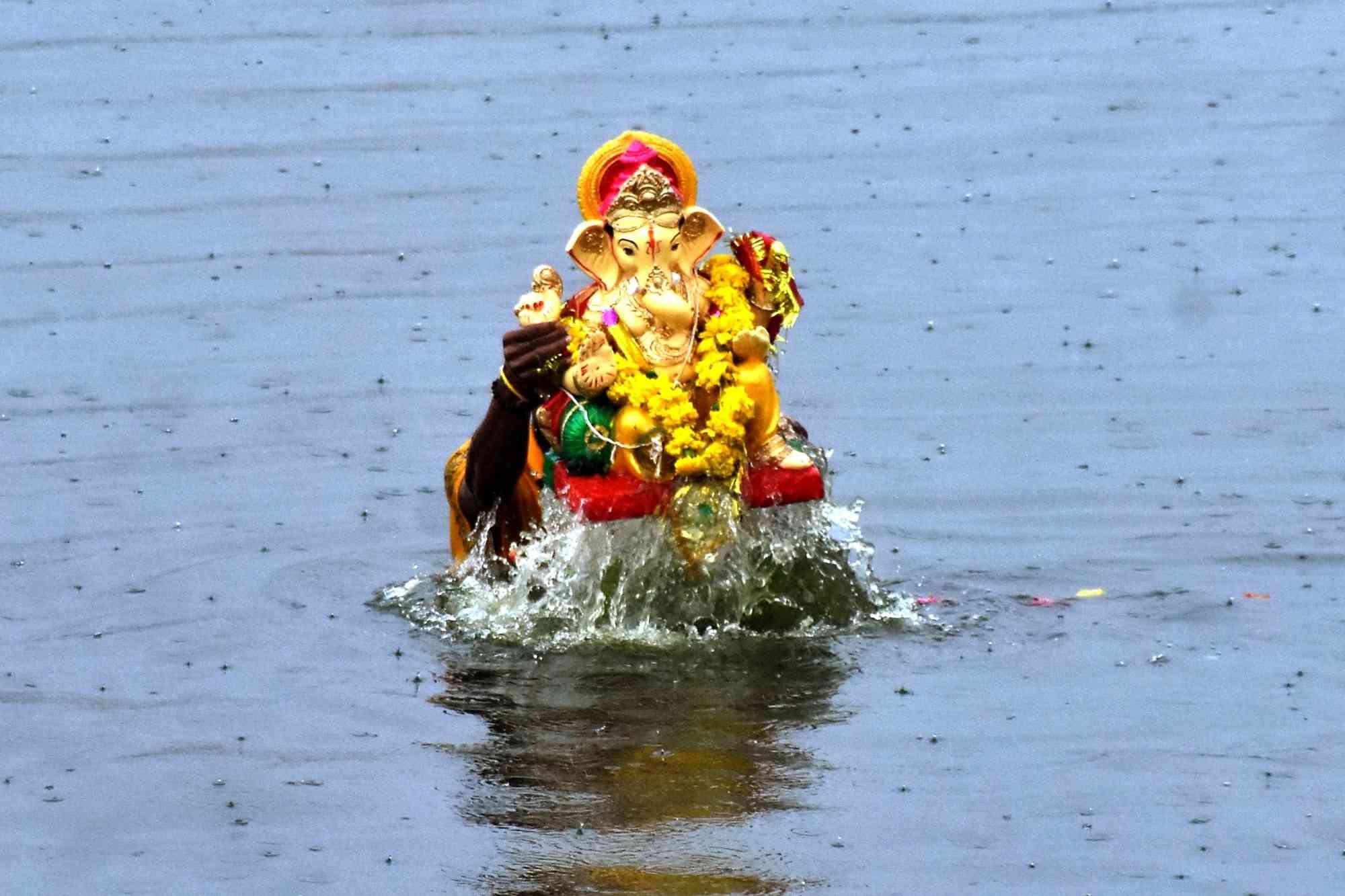 An idol of Ganesh being immersed in Jaipur's Man Sagar lake on Sunday. (Credit: IANS)