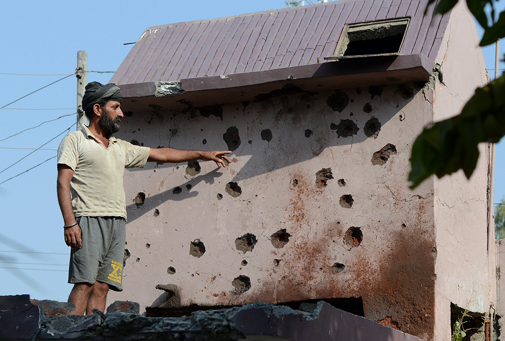 Homes in the Gajansoo border village were damaged in cross-border firing in the Kanachak sector, about 25km from Jammu, on October 24.  Credit: AFP