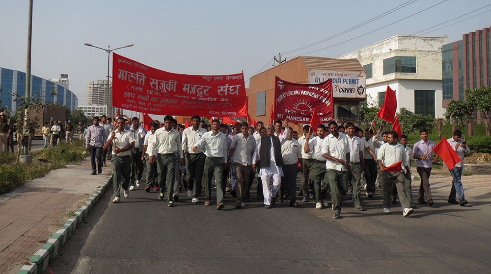 The Maruti Suzuki Workers Union leads a protest march with other plant-level and central unions in Manesar on Thursday.