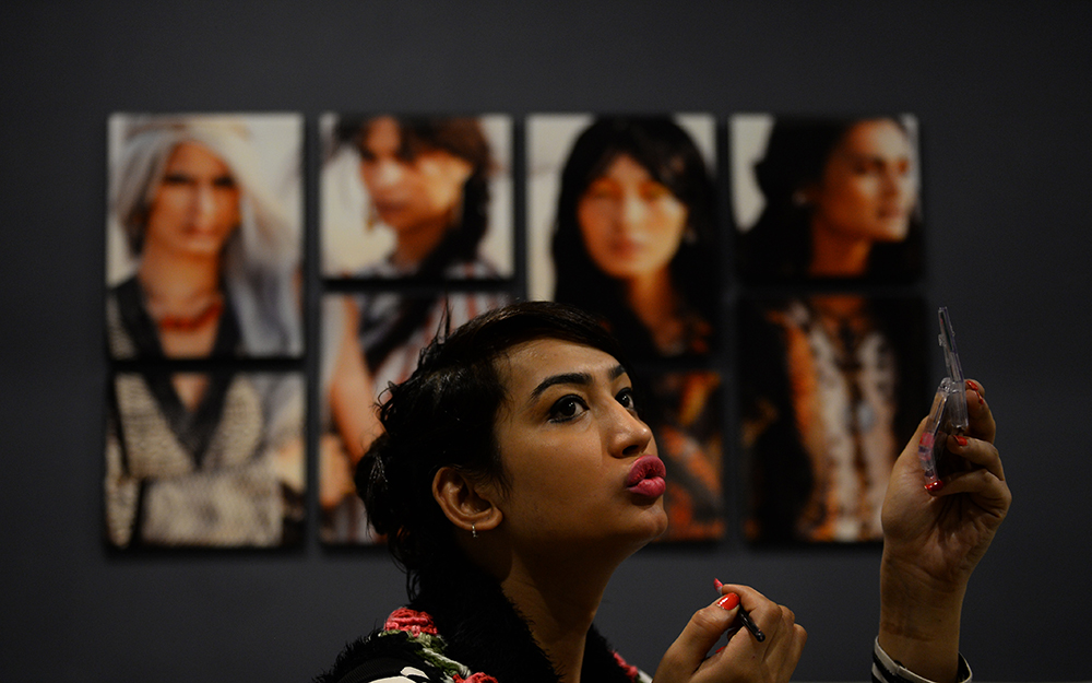 A transgender person waits for an audition. Credit: Sajjad Hussain/AFP