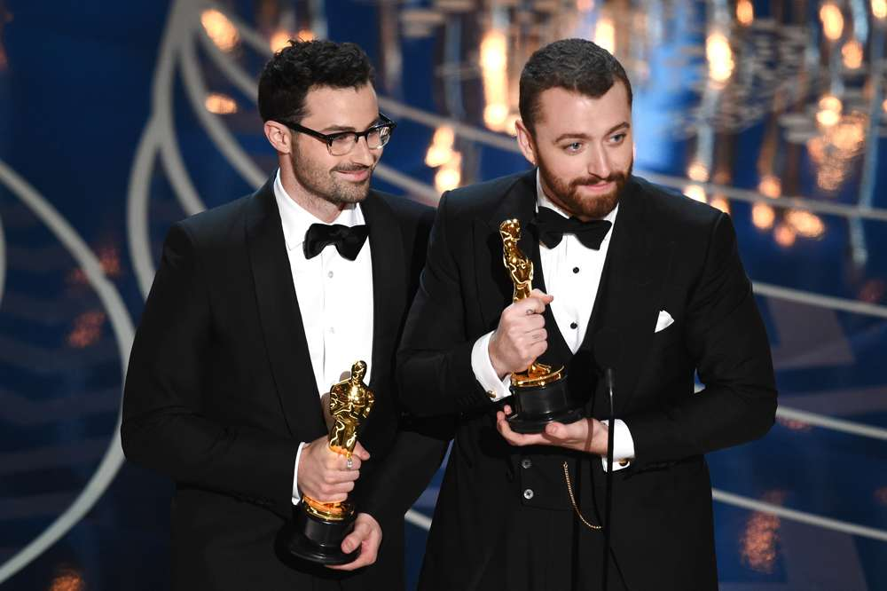 Sam Smith (right) who won the Oscar for Original Song, used the stage as a platform for gay rights.