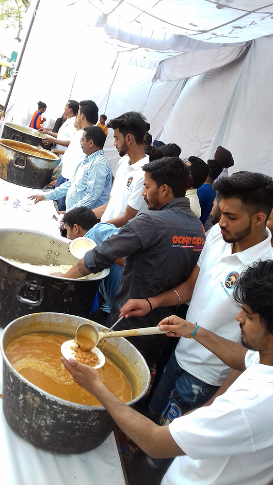 Ankit Saxena's friends serve piping hot rajmah chawal – his favourite – at the prayer meet.
