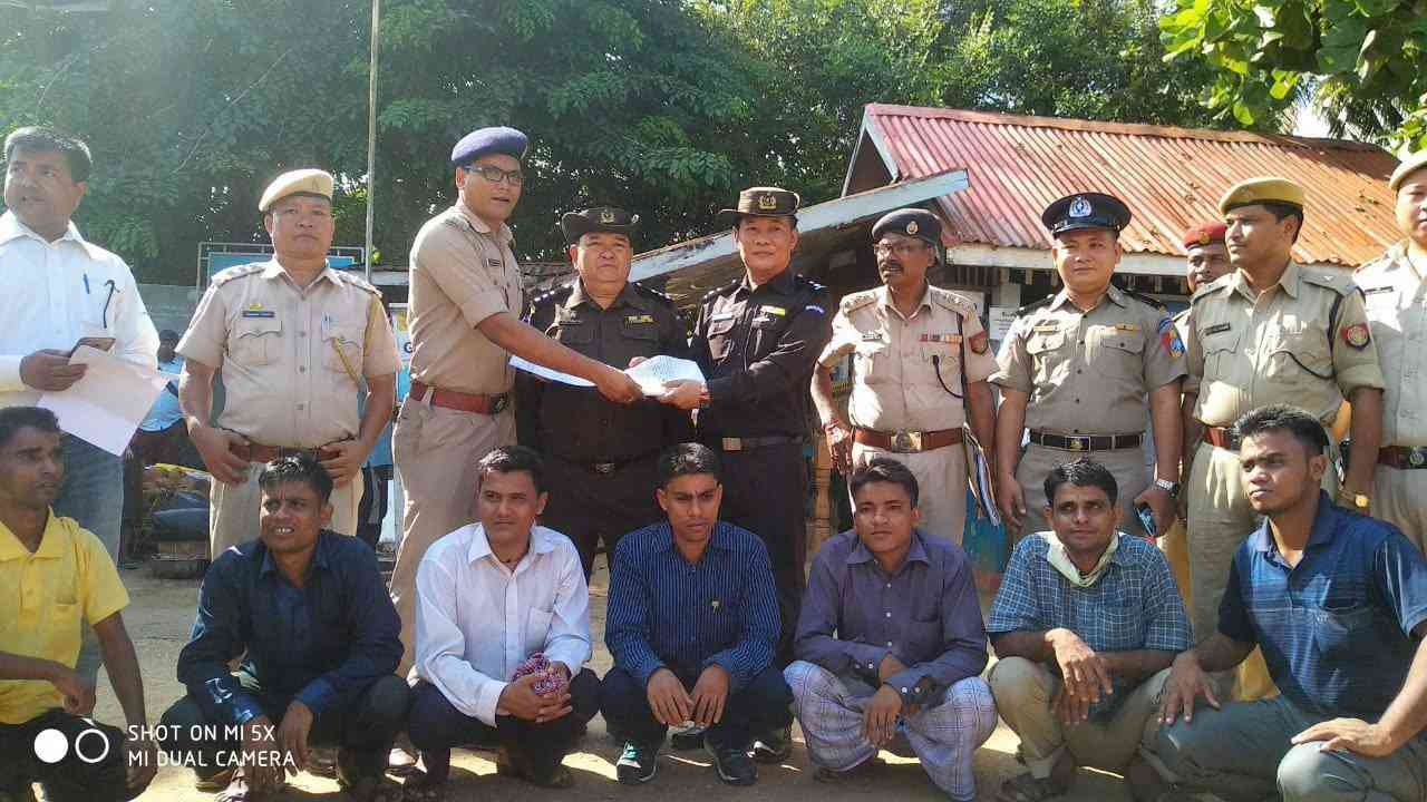 The Assam Police hand over the seven men to Myanmar authorities at Moreh border post in Manipur on October 4. (Photo released by Assam Police via PTI)