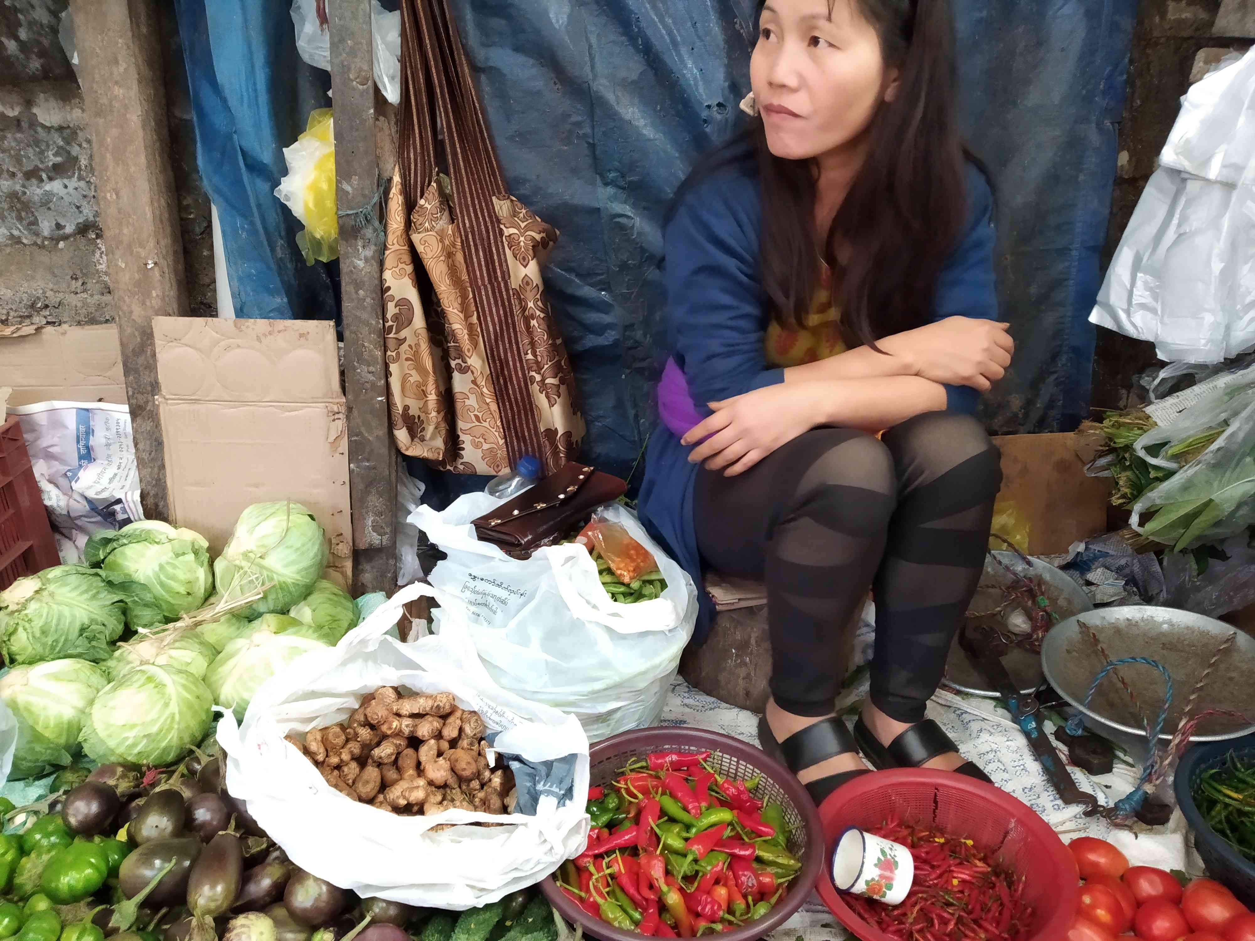 A woman selling ginger in an Aizawl market. (Credit: Arunabh Saikia)