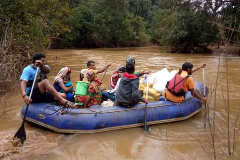 Rescue workers take stranded people to safety during the floods. (Photo credit: Gayatri Gulati)