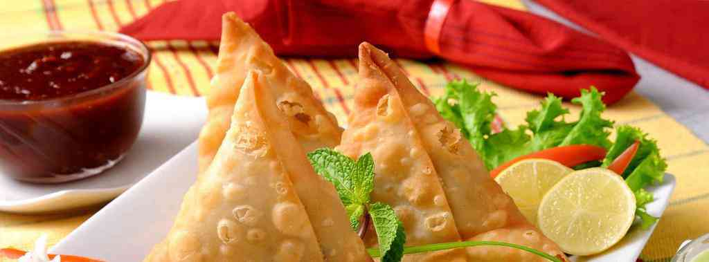 "The Hindi word ""samosa"", the name of India's most popular snack, also has Persio-Arabic origins, tracing its roots to when medieval India was ruled by Muslim kings."
