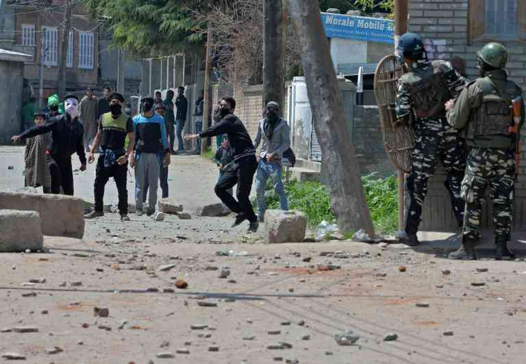 Protestors pelt stones near a polling station in Srinagar in April 2017. The bye-election saw a turnout of 7.13%. Photo credit: AFP