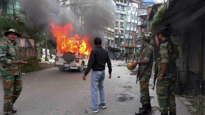 A vehicle burns after it was set on fire by protesters in Darjeeling in July. (Photo credit: PTI).